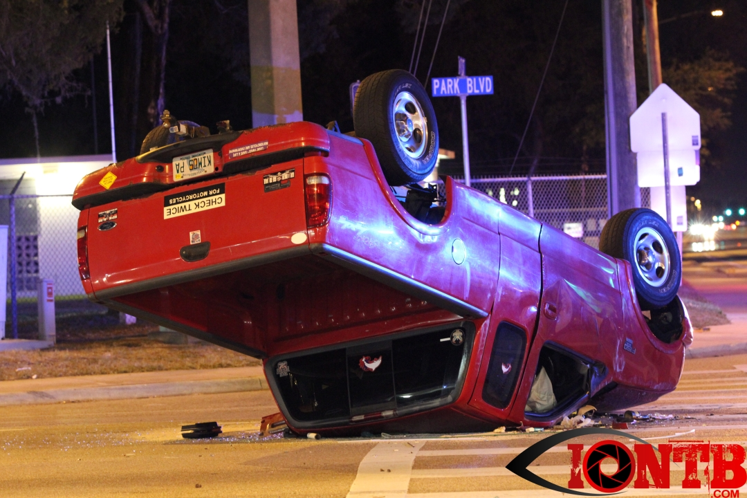 Pickup overturns in collision at Park and Belcher
