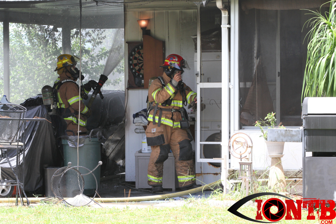 Vehicle fire in carport spreads to manufactured home in Largo