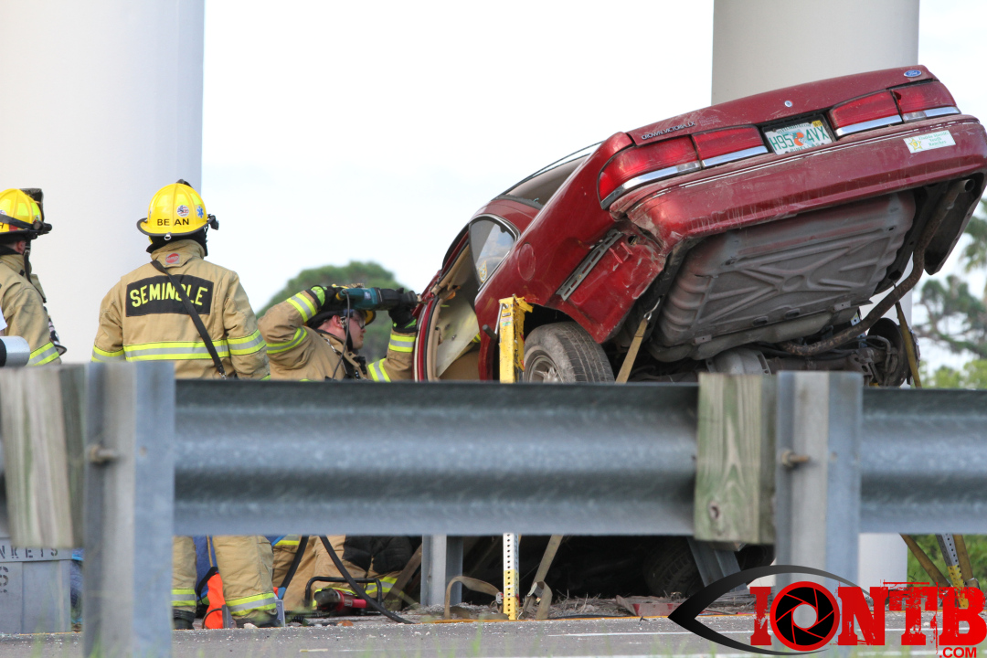 Seminole crew extricates patient from vehicle hanging from overpass guardrail