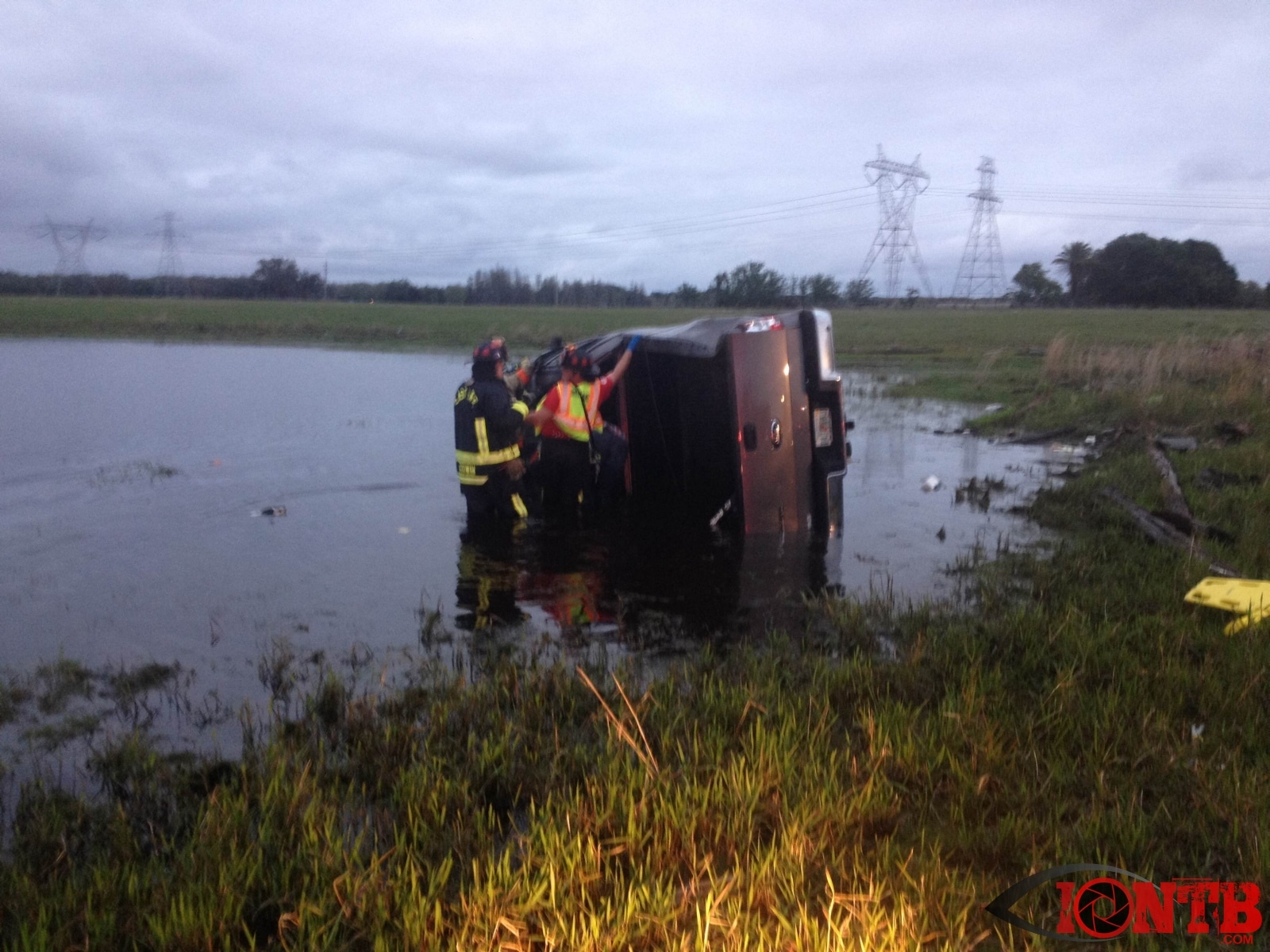 Driver In Partially Submerged Vehicle Rescued by Good Samaritan