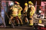 Firefighters from Seminole Fire Rescue Department cut the roof from a Hummer on its side