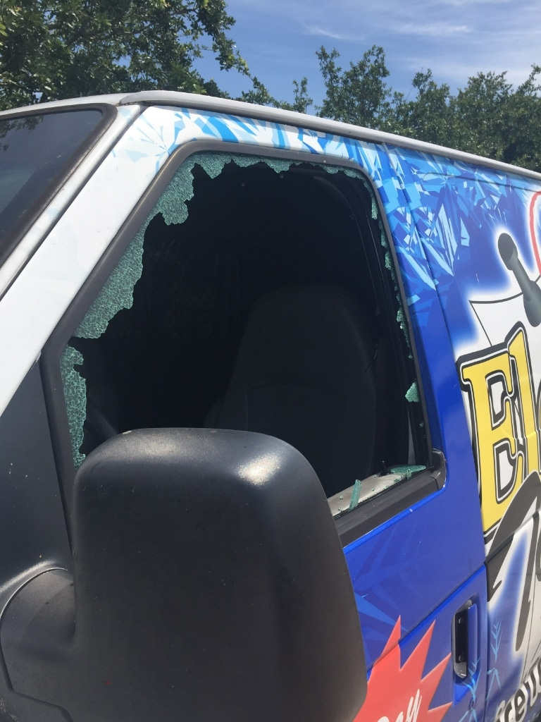 Damaged window of the van. Photo courtesy of FHP.