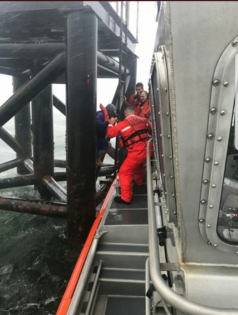 Coast Guard rescues 2 brothers clinging to range light in Tampa Bay