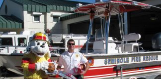 """Sparky the Fire Dog and Seminole Fire Rescue District Chief Lance Volpe ask you to come out and """"Fill the Fire Boat with toys for underprivileged children December 16 at the Seminole Walmart at Bay Pines."""
