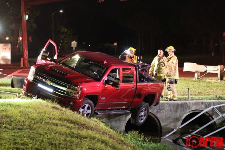 Firefighters rescue two occupants of a truck in Pinellas Park