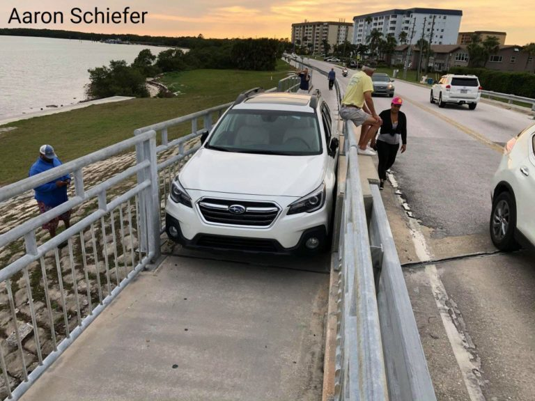 Drunk driver wedges vehicle between railings of pedestrian walkway attempting to drive over Dunedin Causeway