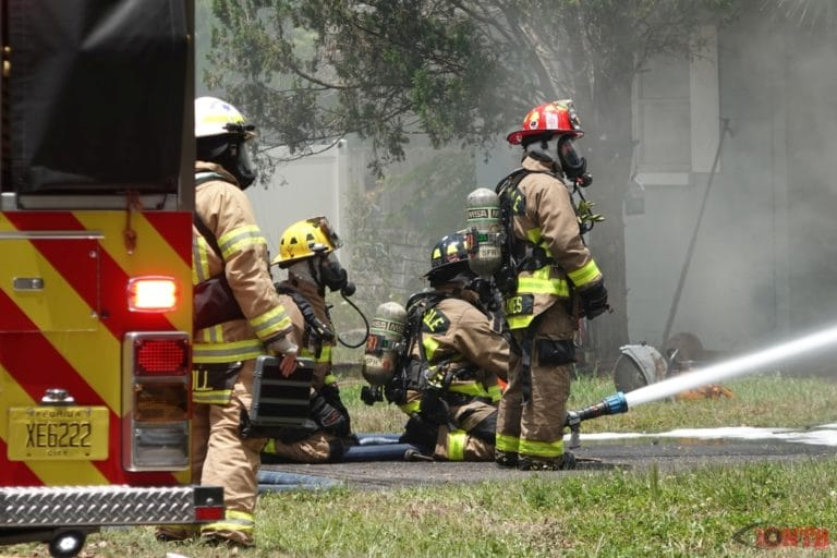 Firefighters battle structure fire at a home in unincorporated Seminole
